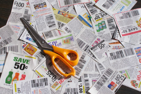 Pair of scissors laying on spread newspapers