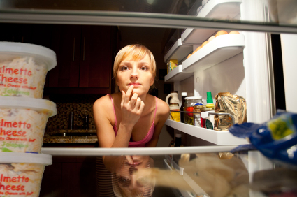 A lady looking into the refridgerator