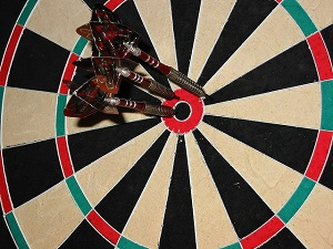 Dartboard with all darts in the centre